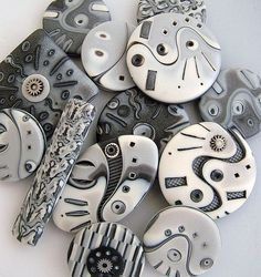 An ode to the silver screen.stark shades of graphite, grey, silver, platinum and pearly white are mysterious, elegant and timeless. Polymer Clay Pendant, Fimo Clay, Polymer Clay Projects, Polymer Clay Creations, Polymer Clay Beads, Filigranes Design, Clay Design, Metal Clay Jewelry, Ceramic Jewelry