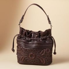 """This exquisitely hand-detailed leather bag has a place for everything in its five pockets (four inside, one out). Magnetic closure. Imported. 10-3/4""""W x 6""""D x 12""""H"""