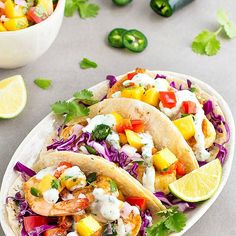 Spicy Shrimp Tacos with Mango Salsa Recipe Main Dishes with mango, purple onion, jalapeno chilies, red pepper, fresh cilantro, lime, salt, pepper, olive oil, shrimp, chili powder, paprika, cayenne pepper, salt, greek yogurt, fresh cilantro, lime juice, minced garlic, corn tortillas, red cabbage, lime wedges