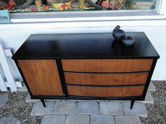 Small MCM (mid century modern) buffet, tv stand, dresser. The case has been painted a solid smooth black and the door/drawer fronts stained walnut. Modern Vintage