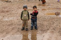 Two little boys wait their turn to get fitted for boots in a refugee camp in Iraqi, Kurdistan. Spirit of America has donated tens of thousands of rubber boots to the most needy children fleeing violence in Syria and Iraq. #boots #ISIS #refugees #SpiritofAmerica #SoA #donate #help #winter #iraq #Syria #Kurdistan