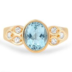A glistening aquamarine is bezel set among glittering diamond accents. Set in a unique 18K yellow gold Retro-era setting, the Tawnya Ring is a classic heirloom piece #BrilliantEarth