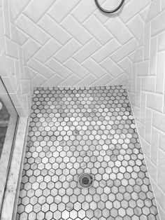 Bathroom floor tile. Herringbone beveled white subway tile. Marble hexagon mosaic sheet floor tile.