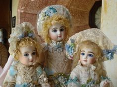 "We Three - AT, AT Kestner, and Portrait Jumeau ""Pauline"", all dressed in antique lace and ribbonwork, all made by the artist"