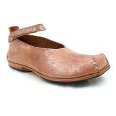 Cydwoq shoes.  Ugly-pretty shiny tan leather.  Part cowboy boots, part clogs.