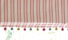 Do you know we offer a Made to Measure Curtain & Blind Making Service from Susie Watson Designs? This blind is made from Red Ticking Stripe Fabric...http://www.susiewatsondesigns.co.uk/shop-by-product/fabric-cotton/Fabric-235-Red-Medium-Ticking-Stripe.html with a pom pom trim!