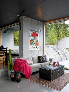Eclectic/industrial living space - adore the chest, cactus & lanterns. What beautiful scenery.