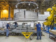 Pieces for the Orion spacecraft that will fly on Exploration Mission 1 are being prepared for welding