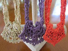 Ravelry: Melanie's Necklace pattern by Julie Blagojevich; clasp-free silk necklaces.