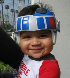 Artist Paula Strawn paints boring white medical helmets for babies into something cool! What is Cooler than Star Wars?