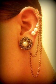 ear cuffs and multiple piercings. :)