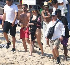 A distraction: The fun-filled beach day was likely a nice distraction forKhloé, who said recently that she is worried estranged husband Lamar Odom will slip back into old ways due to 'hanging out with bad guys again'
