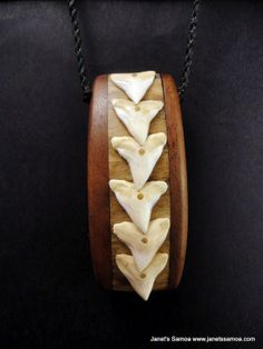 Janet's - Pacific Wood Pendant BRPWD13, 159.00 AUD (http://www.janetssamoa.com/pacific-wood-pendant-brpwd13/) Composite Tapa Board made from Swordfish (middle section) Coconut Wood and Pacific Tiger Shark Teeth. Polynesian Afa (Coconut Husk) Threaded into Wood