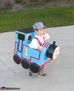 Thomas the Train costume creator:My 2 year old, Brice, is obsessed with Thomas the Train and I did not like any of the store bought versions so I decided to give costume making a try. It is simply two boxes decorated with blue duck tape, red ribbone, black duck tape and foam board.