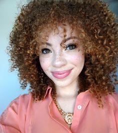 short curly kinky red brown hair. bangs. pink lips. freckles