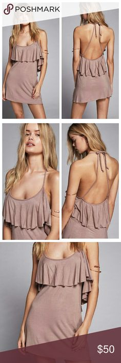 """Free People Alexa Halter Mini Dress FP Beach Alexa Halyer Mini Dress  Made from our jersey Beach fabric this mini dress features a femme ruffle overlay along the bust and a low scoop back. This effortless style has an adjustable halter neck and unfinished trim.  - 95% Rayon, 5% Spandex - Machine Wash Cold - Bust: 31"""" = 78.74 cm - Length: 26.5"""" = 67.31 cm - Color: Taupe Free People Dresses Backless"""