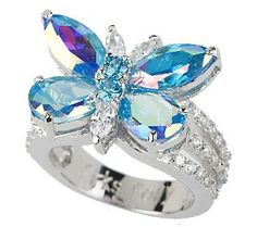 An enchanting monarch butterfly dazzles atop this silvertone ring. The body of the colorful creature is fashioned with marquise- and pear-shaped, aqua blue aurora borealis crystals, along with round blue crystals and marquise-shaped clear crystals. Butterfly Ring, Butterfly Jewelry, Monarch Butterfly, Marquise Cut Diamond Ring, Uncut Diamond, Diamond Rings, Antique Jewelry, Silver Jewelry, Jewelry Sites