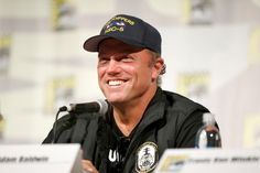 """Adam Baldwin Photos Photos - Actor Adam Baldwin speaks onstage at """"The Last Ship"""" panel during TNT at Comic-Con International: San Diego 2015 on July 9, 2015 in San Diego, California. 25568_001 - TNT at Comic-Con International: San Diego 2015 - 'The Last Ship' Panel"""