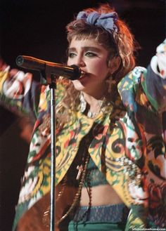 Madonna, 80s. eyebrows.