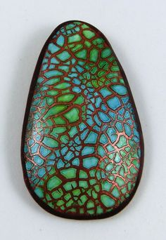 Crackle Technique - Sculpey base, copper paint, Kroma Crackle, dry for 24 hours ( it changes from clear to white), drop alcohol inks on felt, spritz with alcohol so that they bleed through the felt. Let dry 30 minutes or until the colors start to show, cut pendant shape, place on curved glass for baking. Make Sculpey back. Bake again. Put back and bale on. Baka again. Put Sculpey glaze on it.