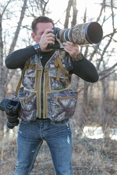 Serengeti Photo Vest Camera Vest,  This vests is Made in the USA, designed to carry 1 or 2 Cameras,  plenty of pockets for Lens, Filters, Batteries, Memory Cards, Teleconverters, Water, Telephoto Lens, Wide Angle Lens, Breathable Mesh Camera Vest, Great for Wildlife Photographers, Sports Photographers, Outdoor Photographers