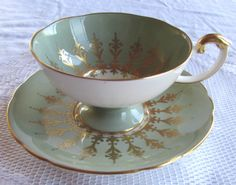 Aynsley Green and Gold Footed Pedestal Tea Cup and Saucer