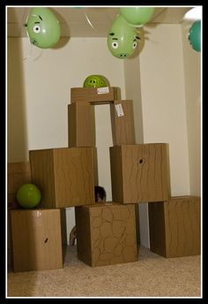 angry birds game with boxes, use a ball to try to knock the green balloon pigs off the boxes.