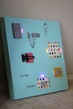 DIY activity board for kids (with actual lights that turn on!)