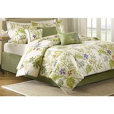 Madison Park Kannapali Set features a tropical floral design printed on cotton twill. Set includes comforter, 2 pillow shams, 1 bed skirt (15'' drop), a...