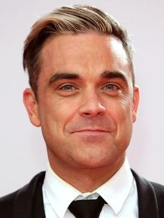 Robbie Williams: My daughter has united my family - but she'll be embarrassed by me when she's older