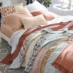 GET THE LOOK: MODERN FARMHOUSE 1. Start with lofty cloud-like layers and quality pillows. 2. Choose sheets that have a soft feel and a restful color palette. 3. Layer on a blanket for more texture and color. 4. Make a statement with a bold, artistic quilt. The hand-stitched details will add depth. 5. Top with a colorful throw for an elegant touch. 6. Anchor the room with a patterned rug, an ideal way to soften hardwood floors. Hardwood Floors, Flooring, Bedding Basics, Quilts, Bath Decor, Blanket, Luxury Bedding, Bed Sheets, Modern Farmhouse