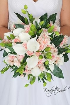Light pink brides bouquet with calla lilies, cherry blossoms and mixed greenery silver dollar eucalyptus