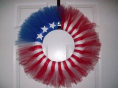 Fourth of July wreath made from tulle. @Theresa Slaughter Santos-got any tulle in these colors? This would be cute...