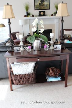 Tips on styling a Sofa Table! How to use a sofa table to define your living room space, style it with decor and lamps, store pillows and books! Sofa Table Styling, Sofa Table Decor, Sofa Tables, Table Decorations, Console Table, Centerpiece Ideas, Living Room Sets, Living Room Decor, Small Basement Remodel