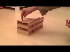 Step by step instructions on how to build a house using Kapla Blocks.
