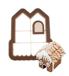 Mini gingerbread house cookie cutter. Sits on the side of a coffee mug.