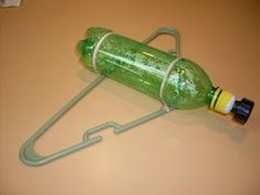soda bottle sprinkler- u could just duct tape the top to hose too after stabbing holes in it- if u dont wanna mess with nozzles Cool Diy, Coffee Filter Uses, Coffee Filters, Pop Bottle Crafts, Homemade Sprinkler, Large Rubber Bands, I Spy Diy, Water Sprinkler, Pop Bottles