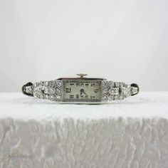 Art Deco Platinum and Diamond Dress Watch. Lady's Cocktail Watch with Rectangular Face, Circa 1920s.