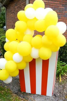 Don't miss this fun circus birthday party! The popcorn balloon decorations are awesome! See more party ideas and share yours at CatchMyParty.com #catchmyparty #partyideas #circus #circusparty #boybirthdayparty #popcorn #thegreatestshowman