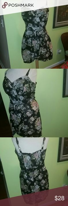 Fun and Flirty Muted Toned Floral Sundress What an ABSOLUTELY flirty sundress for the woman that's confident with flaunting her curves. The style potential is ENDLESS. The fiber consist of cool comfy cotton. This is a size 2X that measures BUST: 46 inches,  WAIST: 40 inches and LENGTH: 36 inches. This item is in EXCELLENT condition. Please be sure to check out my Poshmark Closet. American Rag Dresses