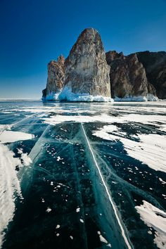 Frozen lake Baikal, Siberia. Read more about this amazing sight in our blog. Click here.