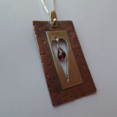 Rustic hand sawed copper & sterling heart pendant by RustyWing
