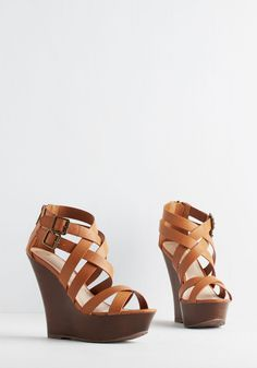 Patio Panache Wedge. Complete the evenings fancy-free ensemble by buckling into these caramel brown wedges before greeting guests outside! #tan #modcloth