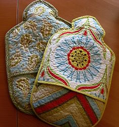 tutorial for stipple quilted hot water bottle cozy - I found a water bottle that I think I purchased with the idea to make a cozy for it and use it. I might need to do this instead.