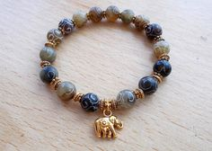 Hey, I found this really awesome Etsy listing at https://www.etsy.com/listing/187802506/jade-elephant-bracelet-beaded-stretch