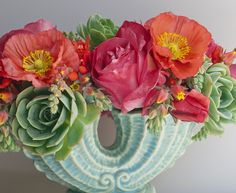Poppies, roses and succulents in a vintage vase.