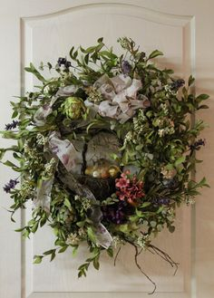 All shades of green make up this elegant wreath that could be used for Easter, Spring, or Summer! A grapevine basket with adorable eggs and bird