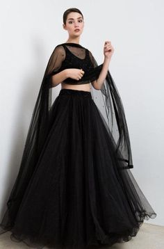 The Stylish And Elegant Lehenga Choli In Black Colour Looks Stunning And Gorgeous With Trendy And Fashionable Beads. The Tulle Fabric Party Wear Lehenga Choli Looks Extremely Attractive And Can Add C. Indian Gowns Dresses, Indian Fashion Dresses, Dress Indian Style, Indian Designer Outfits, Pakistani Dresses, Dress Fashion, Fashion Outfits, Indian Lehenga, Lehenga Choli