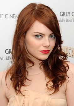 Love Emma Stone. Want her hair color.
