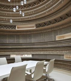 Giant Meeting room composed of cardboard cylinders cut and stacked to create designs and cubbies
